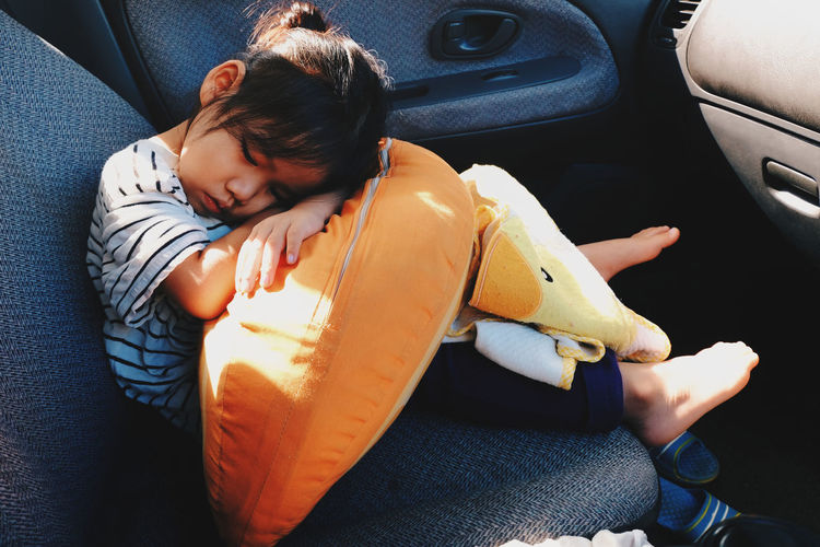 Car Child Day Females Girl Indoors  Lifestyles One Person One Woman Only One Young Woman Only Only Women People Pillow Roadtrip Sitting Sleep Sleepy Trevel Tried Vehicle Breakdown Vehicle Interior Live For The Story The Photojournalist - 2017 EyeEm Awards