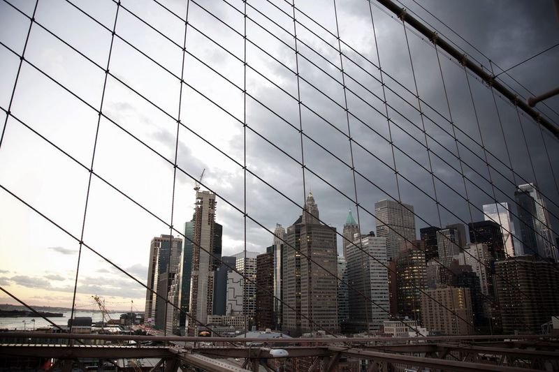 Reflection of cityscape on modern building