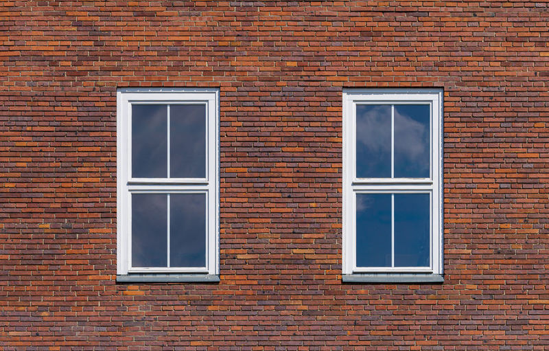 Full frame shot of window on brick wall of building