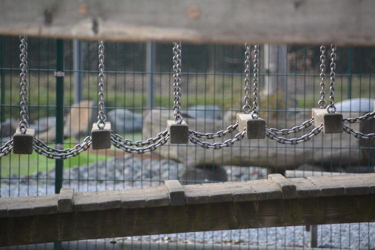 Chain Hanging Over Footbridge