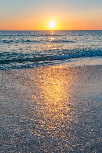 Sea Sunset Scenics Beauty In Nature Nature Water Tranquil Scene Horizon Over Water Tranquility Idyllic Beach Sky No People Sun Wave Outdoors Day