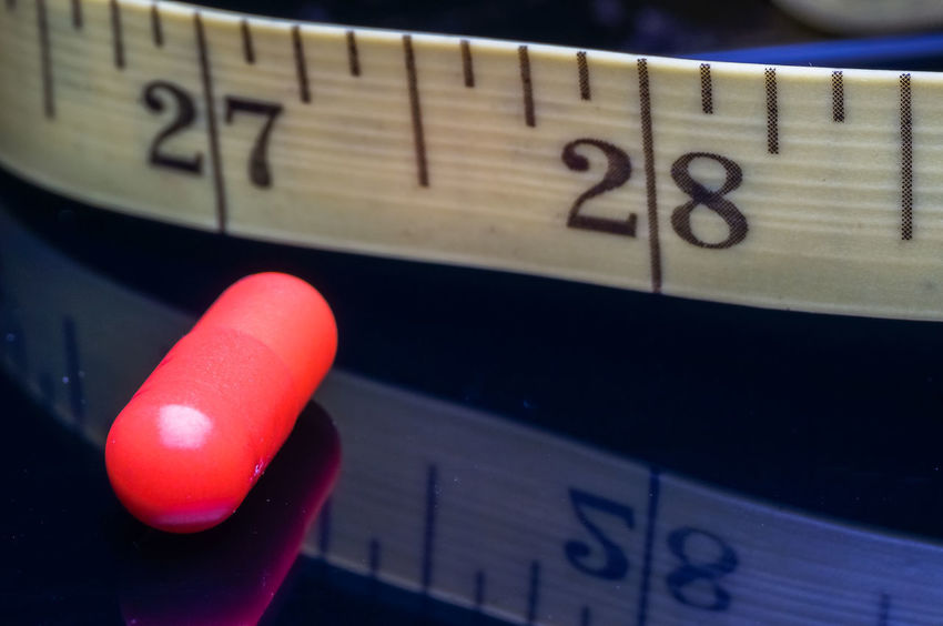 colorful of a medication and measurement tape isolated on black Diet Isolated Reflection Background Black Close-up Colorful Communication Concept Day Healthy Indoors  Measurement Tape Medication Medications No People Number Pill Technology Text Wireless Technology