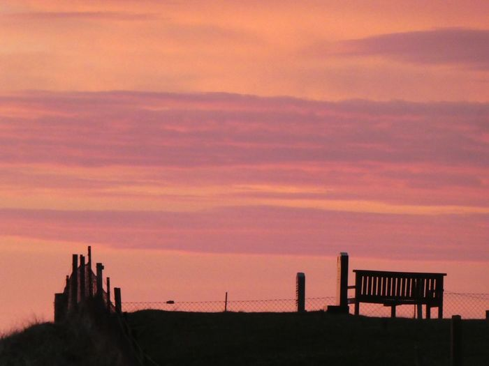 Sunset Seat on Isle of Lewis Seat Sunset #sun #clouds #skylovers #sky #nature #beautifulinnature #naturalbeauty #photography #landscape Isle Of Lewis Outer Hebrides Scotland VisitScotland Nature Photography Sunset Sky Architecture Cloud - Sky Built Structure Building Exterior Orange Color Beauty In Nature No People Nature Scenics - Nature Building Silhouette Tranquility Tranquil Scene Travel Destinations Dramatic Sky Landscape Dusk City