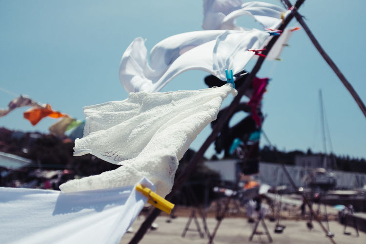 CLOTHESLINES OF AFURADA Clotheslines Threeweeksgalicia Sky Nature No People Day Outdoors Focus On Foreground Textile White Color Selective Focus Clothing Close-up Hanging Flag Transportation Wind Cleaning Rope Moms & Dads