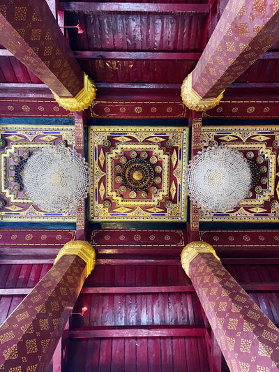 Low angle view of ornate ceiling in temple