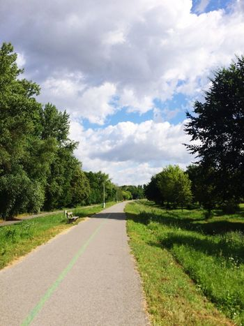 Follow the trail Piešťany Slovakia Paved Path Nature Green Grass Trees White And Grey Clouds Blue Sky White Clouds Bench Lamppost Green Line Bike Lane Running Trail Shadows Summertime
