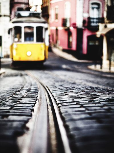 Close-up of yellow train on railroad track