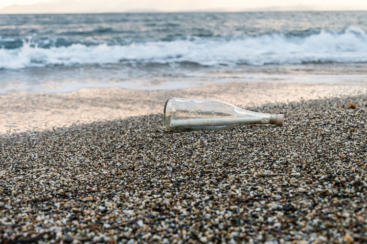 View of paper in bottle on beach