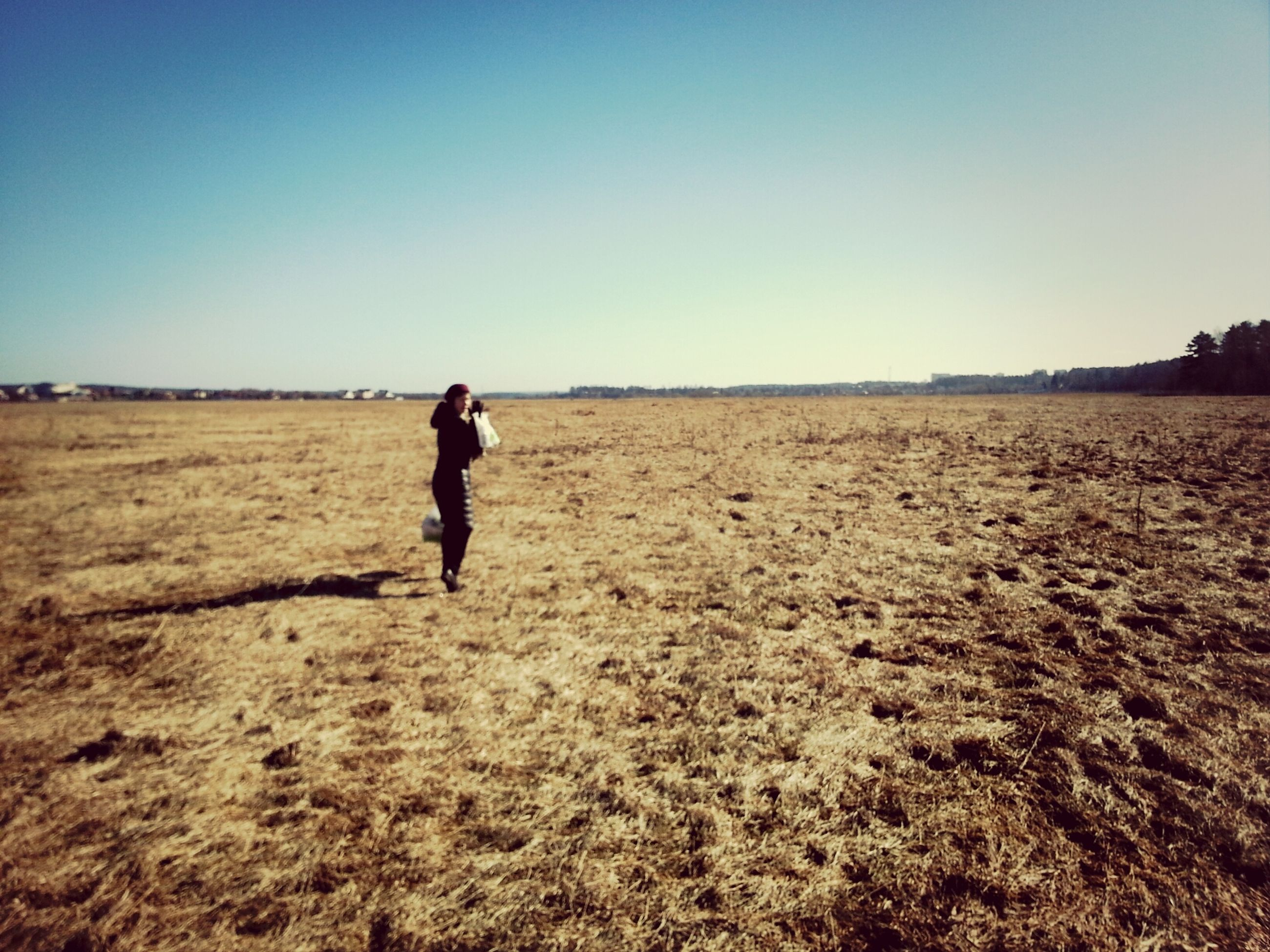 clear sky, copy space, landscape, full length, field, lifestyles, leisure activity, horizon over land, tranquility, rear view, standing, walking, tranquil scene, nature, sand, men, agriculture, solitude