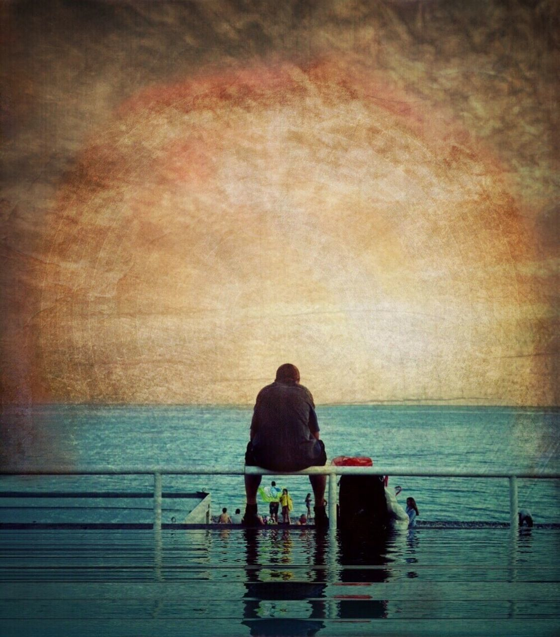 water, rear view, sea, two people, togetherness, men, real people, outdoors, horizon over water, scenics, sky, nature, sitting, day, adult, people