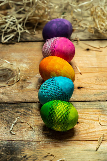 bright, colorful eggs Multi Colored Easter Wood - Material Easter Egg Close-up Pastry Egg Eggshell Holi Various