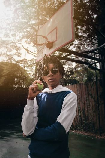 Golden hour Africa Fashion Casualstyle Portrait Photography EyeEm EyeEm Best Shots Canon Pose Tennis Ball Golden Hour Men Standing Sunglasses Mid Adult Holding Fashion Model