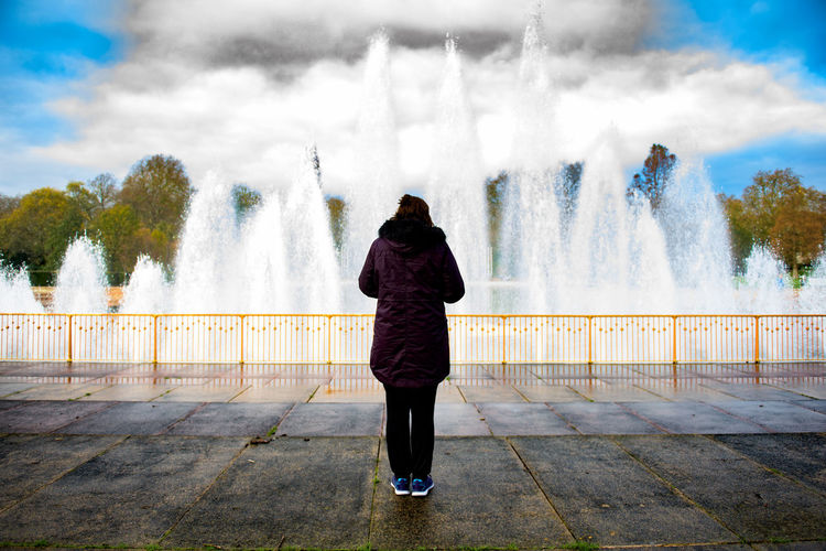 Battersea Battersea Park Blurred Motion Center Cloud Fountain Fountain London One Person Selective Focus Spraying Sunny Walking Seeing The Sights Up Close Street Photography