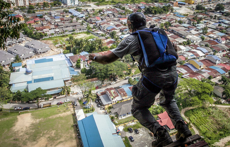 base jump. wira damai extreme park, kuala lumpur Adult Adults Only Architecture Base Basejump Cityscape Day Extreme Sports Jumpers  One Person Only Men Outdoors People Rear View Stadium