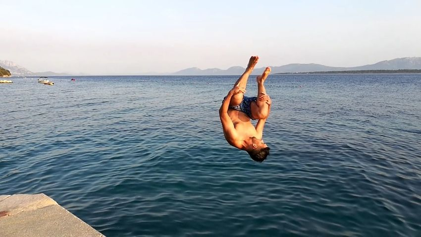 EyeEm Selects Croatia Vacations Beauty In Nature Beach One Person Men Sea Vitality Jumping Jump Jumping Shot Blue Water Reflections Sunset Jumping For Joy Jump In The Water  Flip Backflip