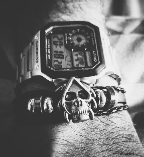 scull and watch