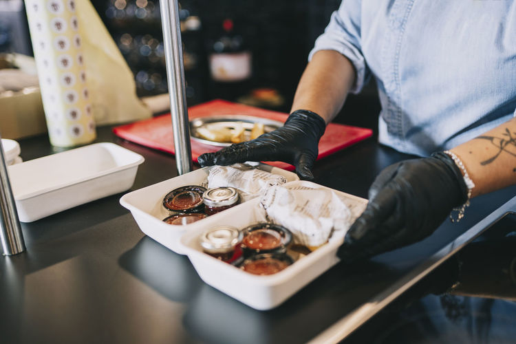 High angle view of man preparing food in restaurant