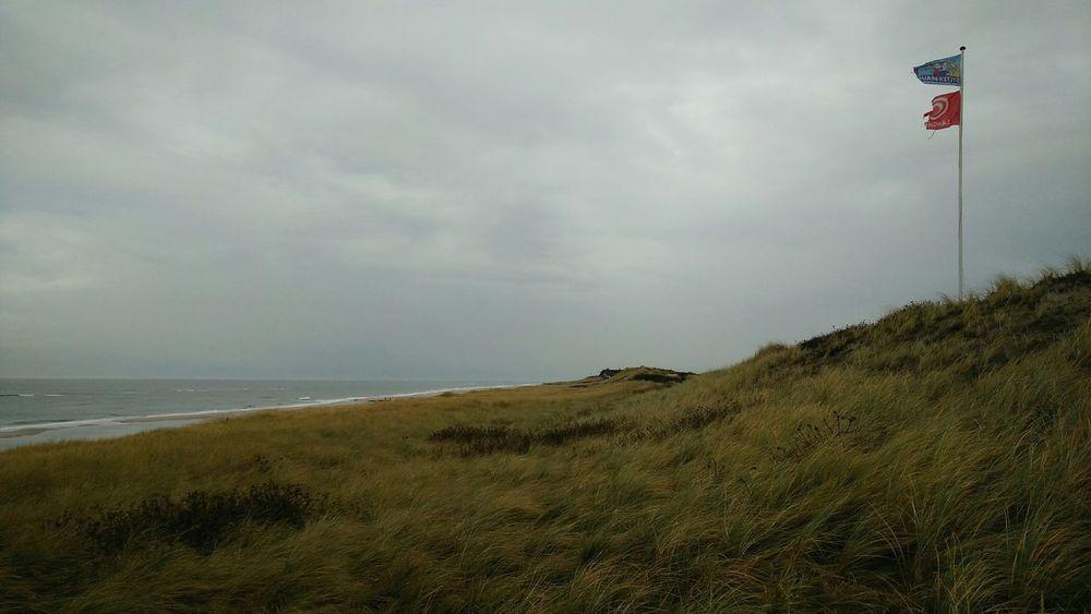 The Flag Pole. · Rantum Sylt Germany Island Nordsee Sea Ocean Grass? Flagpole Flags Gray Cloudy Windy Beautiful