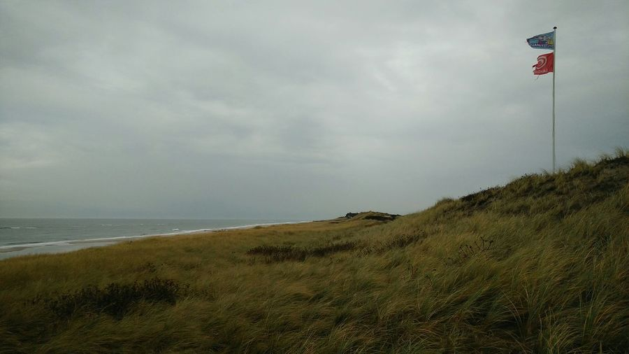 The Flag Pole. · Rantum Sylt Germany Island Nordsee Sea Ocean Grass? Flagpole Flags Gray Cloudy Windy Beautiful