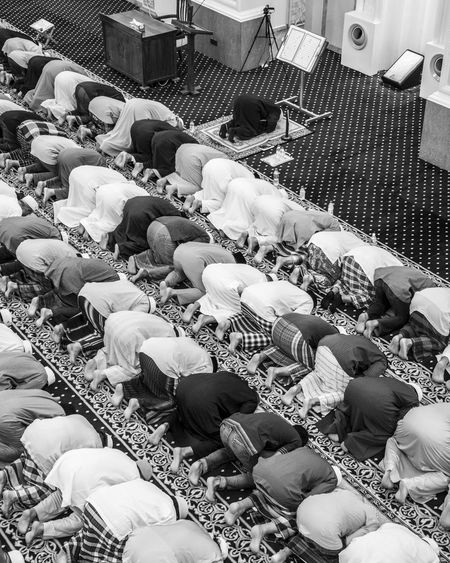 Muslims in prostration during prayer inside a mosque Blackandwhite Bw High Angle View Islam Mosque Muslims Prayer Praying Prostration Ramadan  The Photojournalist - 2017 EyeEm Awards
