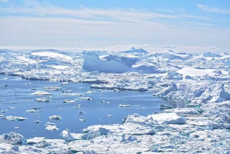 Ilulissat, Greenland, July | UNESCO world heritage site | impressions of Jakobshavn | Disko Bay Kangia Icefjord | huge icebergs in the blue sea on a sunny day | climate change - global warming Beauty In Nature Nature Outdoors Icebergs Iceberg Greenland Climate Change Global Warming UNESCO World Heritage Site Arctic Melting Glacier Natural Beauty Cold Temperature Day Summer Tranquility Nordic Scenery Landscape No People Water Tranquil Scene Environment Scenics - Nature Beautiful