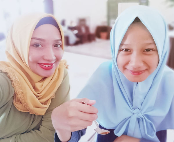 a smile is just like a ball it bounce from person to person with the right friction (read somewhere) Niece  Portrait Smiling Togetherness Looking At Camera Happiness Hijab Headscarf