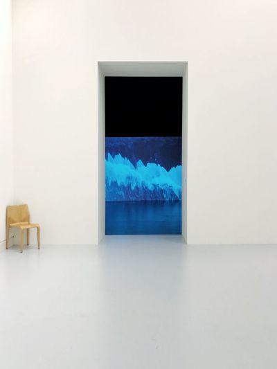 Digital composite image of empty open door