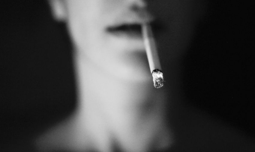 Capture Tomorrow Ash Black And White Fine Art Photography Bokeh Burning Cigarettes Close-up Confidence  Contemplation Detail Face Fire Focus On Foreground Grey Individuality Mouth Night Photography Portrait Selective Focus Shadow Smoking Learn & Shoot: After Dark Woman The Portraitist - 2016 EyeEm Awards Rebel Rebel