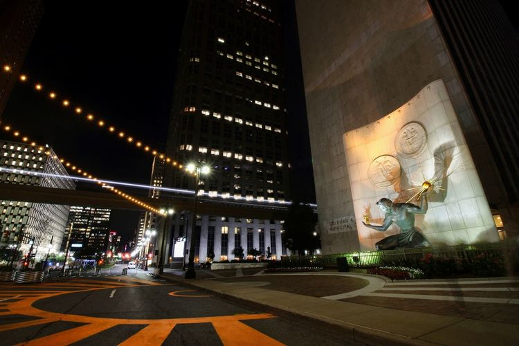 Architecture Night Travel Destinations Illuminated Built Structure Sculpture Statue No People Outdoors City EyeEmNewHere Spirit Of Detroit Statue At Night EyeEmNewHere. Street Scene Wide Angle
