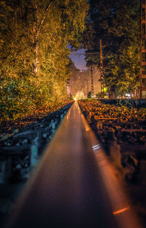 Below Endless Exposed Illuminated Infinity Nature Nature And City Neverending Night No People Outdoors Perspective Public Transportation Rail Rail Transportation Road Rocks Special Speed The Way Forward Tram Tracks Tree