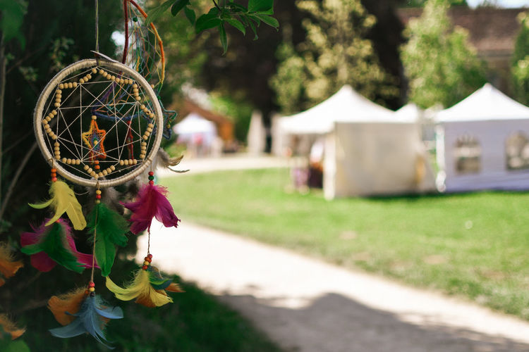 Dreamcatcher Focus On Foreground Plant Nature Day Decoration Art And Craft No People Hanging Grass Outdoors Creativity Craft Belief Growth Religion Tree Field Architecture Luck Religious Equipment