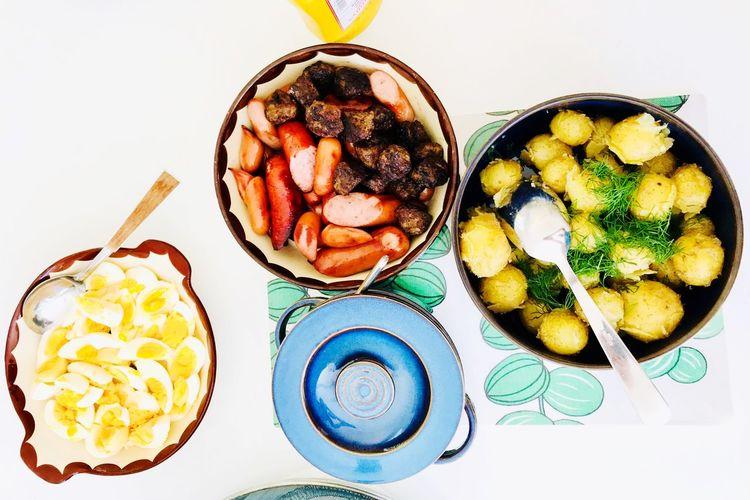 midsommar dish Table Plates Kötbullar Egg Sausage Potatoes Hering Fish Dish Food Ängelholm Midsommar Sweden