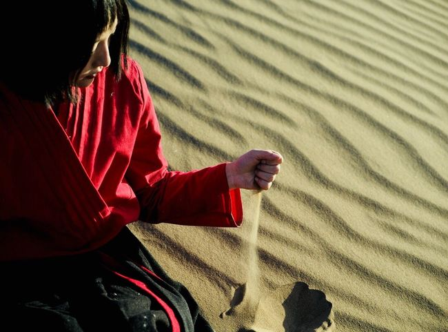 RunningSand Sand One Person People Nature Sitting Lifestyles Human Body Part Real People Child Outdoors Adult Children Only Day Sand Dune Young Adult Human Hand Be. Ready.