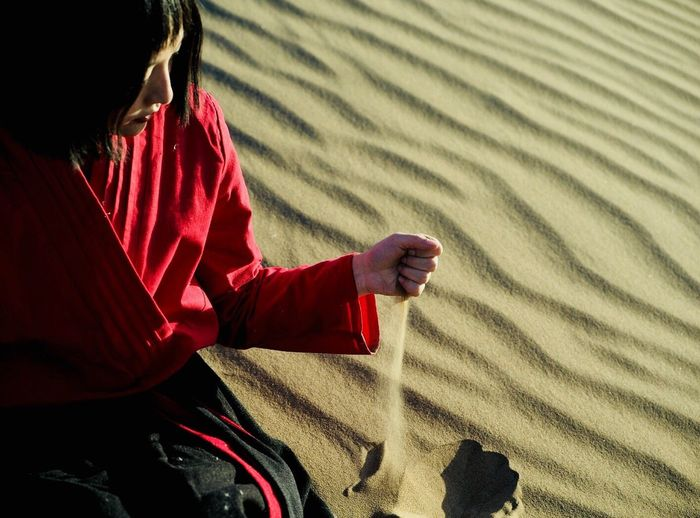 RunningSand Sand One Person People Nature Sitting Lifestyles Human Body Part Real People Child Outdoors Adult Children Only Day Sand Dune Young Adult Human Hand Be. Ready. The Traveler - 2018 EyeEm Awards