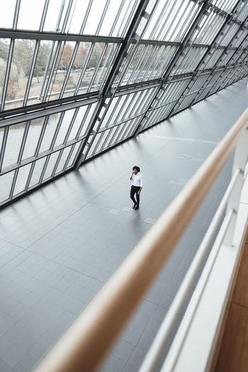 High angle view of man walking on railing