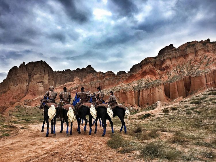 Cloud - Sky Tourism Full Length Tourist Men Travel Destinations Travel Rock - Object Horse Sky History Famous Place Rock Formation Physical Geography The Past Casual Clothing Outdoors Non-urban Scene Adventure Day
