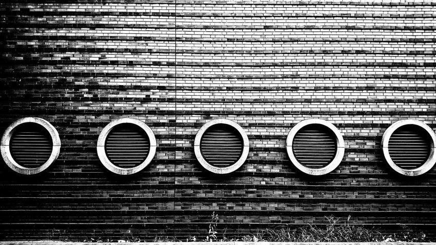 It goes round and round and round... Concrete Concrete Wall Streetphotography Circles Blackandwhite Black And White Berlin Photography cityscapes Full Frame Backgrounds Communication Text Pattern Close-up