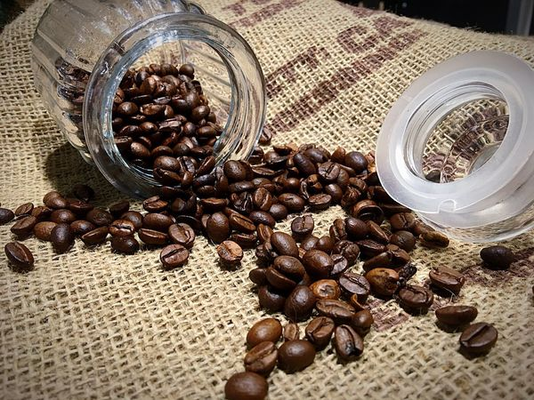 Roasted Coffee Bean Brown Food Food And Drink Seed Roasted Large Group Of Objects Freshness Close-up Raw Coffee Bean Coffee Bean Indoors  No People