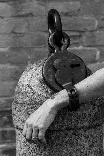 Locked Lock Nofreedom EyeEm Selects One Person Human Body Part Hand Human Hand Real People Metal Focus On Foreground Holding Body Part Close-up Architecture Finger Strength