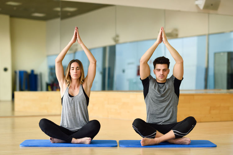 Friends Doing Yoga At Gym