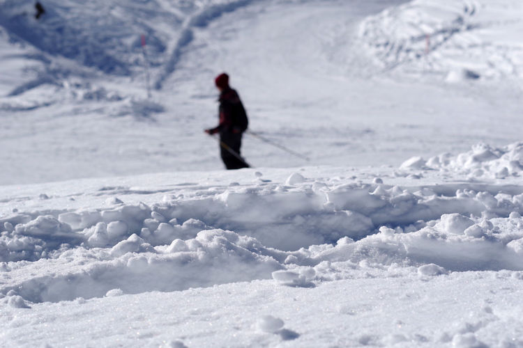 Person skiing on snow covered land