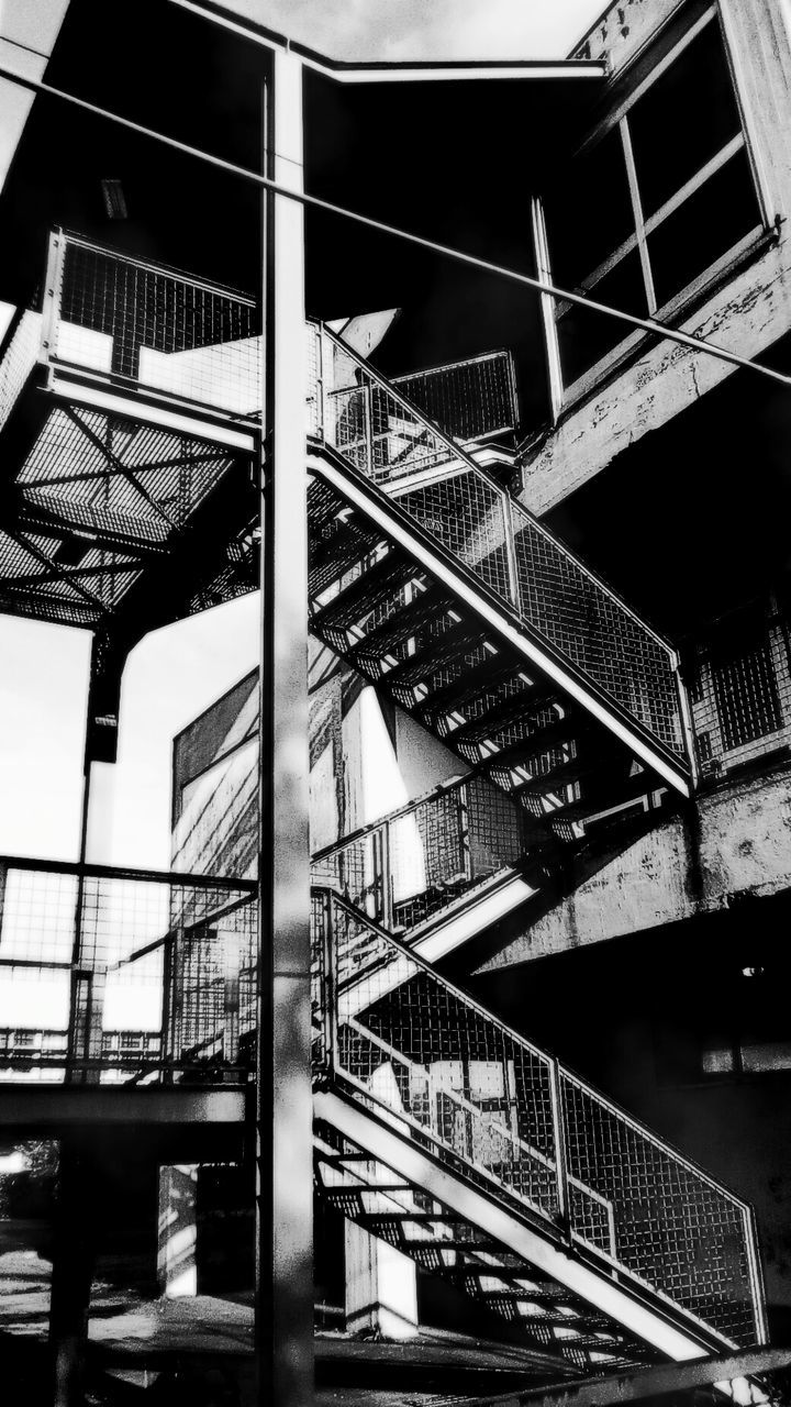 architecture, built structure, staircase, steps and staircases, fire escape, railing, low angle view, building exterior, steps, no people, city, outdoors, day, sky