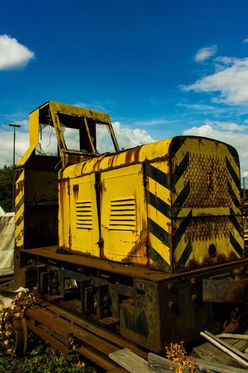 Old Train Train EyeEm Gallery EyeEm Selects EyeEm Best Shots Sky Nature No People Day Sunlight Architecture Built Structure Abandoned Blue Cloud - Sky Building Exterior Obsolete Transportation Outdoors Metal Train Mode Of Transportation Old Yellow