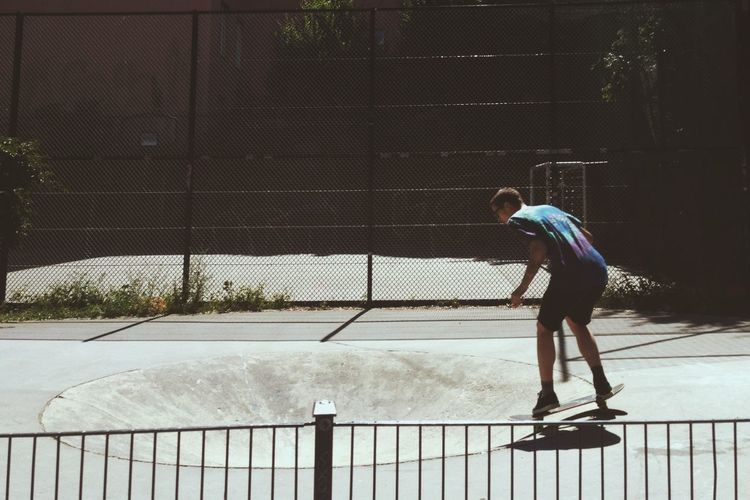 Full length of a young man skateboarding