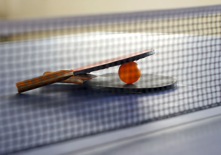 Close up of tennis rackets on table