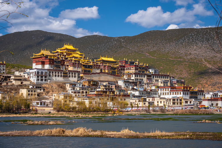 Architecture Building Exterior Built Structure Mountain Building Water Sky Residential District Cloud - Sky Nature City House Mountain Range No People Day Religion Land Spirituality Outdoors TOWNSCAPE Shangrila Shangri-La Yunnan China Tibet Temple Architecture History UNESCO World Heritage Site Beautiful