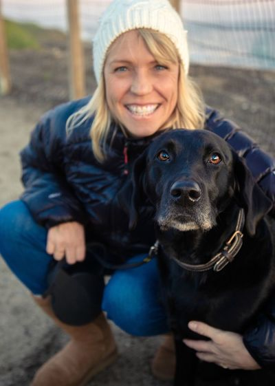 Portrait of smiling woman with dog