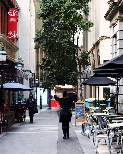 Architecture Building Exterior City Street Built Structure City Life Walking City Street Outdoors Full Length Cafe Day Men Travel Destinations Real People Adult People Pedestrian Adults Only Only Men