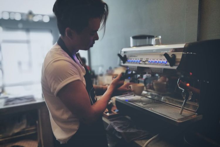 EyeEm Selects Business Finance And Industry Small Business Working Business Young Adult Coffee Only Men People Coffee Time Cafe Cafés Cafelife Barista Barista Life Coffee Shop Real People Occupation Relax Music Arts Culture And Entertainment One Man Only Indoors  One Person Adult