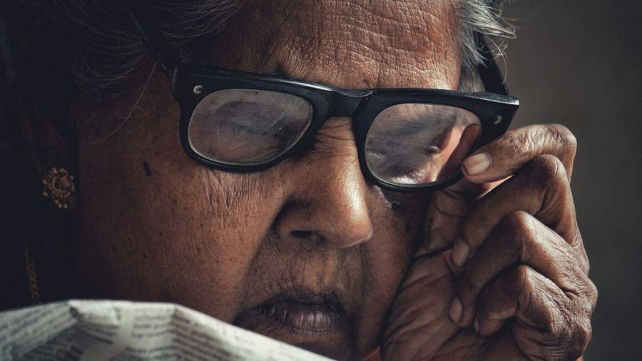 Close-Up Of Senior Woman Wearing Eyeglasses